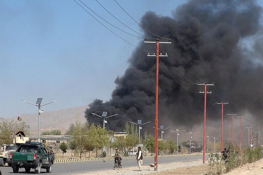 Afghan security forces keeping watch after suicide car bombers and gunmen attacked the provincial police headquarters in Gardez, the capital of Paktia province, in Afghanistan yesterday.