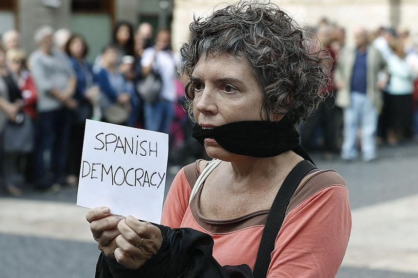 Thousands of people took to the streets of Catalonia yesterday to protest against the move to keep the heads of Catalonia's two main separatist groups, Mr Jordi Sanchez and Mr Jordi Cuixart, behind bars.