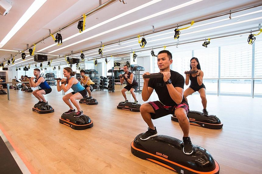 A fitness class at a Pure Fitness gym at Ocean Financial Centre in Raffles Place, Singapore. Hong Kong-based Pure Group's fitness centres cater to the territory's financial elite and many of the gyms occupy prime real estate like IFC Mall.