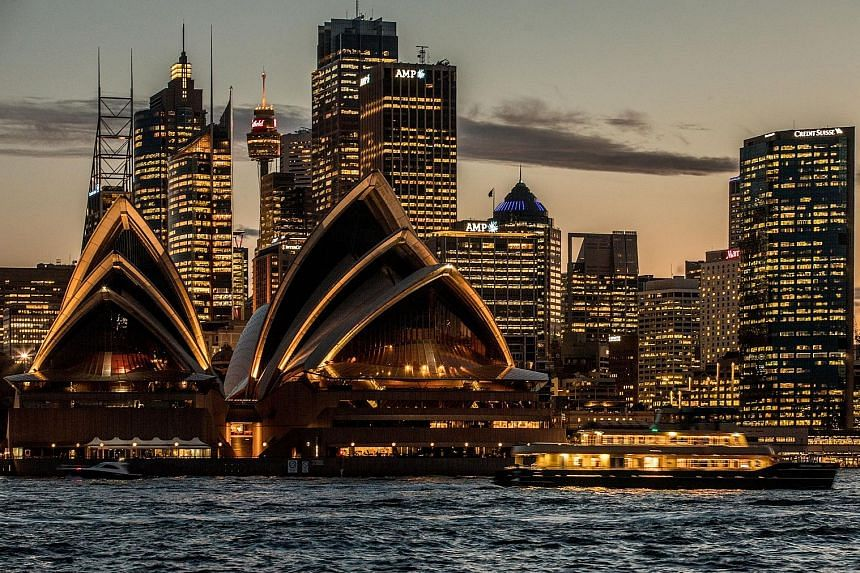 The Sydney Opera House and the city's financial district lit up at dusk. Power shortages and spiralling energy prices in some Australian states have led to growing anger particularly over the fact that the country is a major energy exporter.