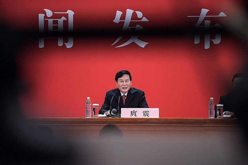 CCP spokesman Tuo Zhen speaking on China's debt at a press conference yesterday, the eve of the opening of the 19th national party congress.