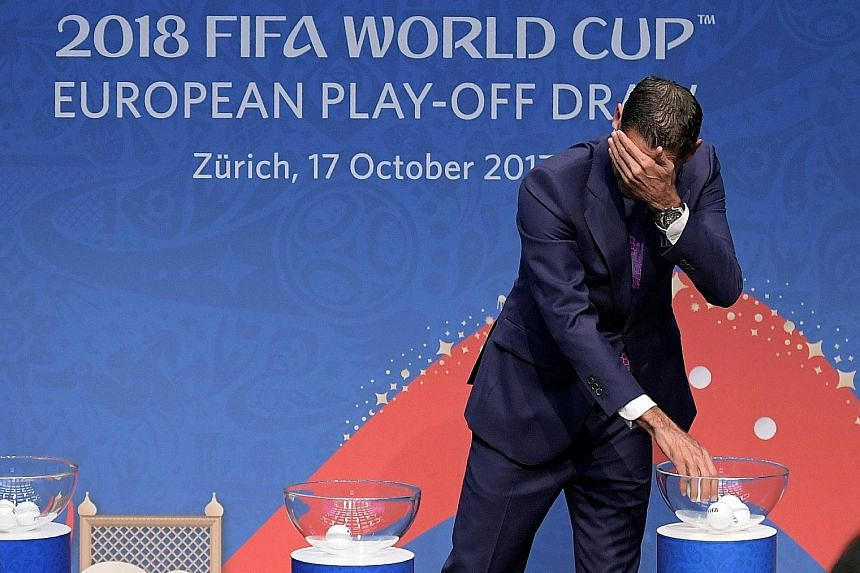 Retired Spanish footballer Fernando Hierro doing the honours at the World Cup European play-off draw yesterday in Zurich.