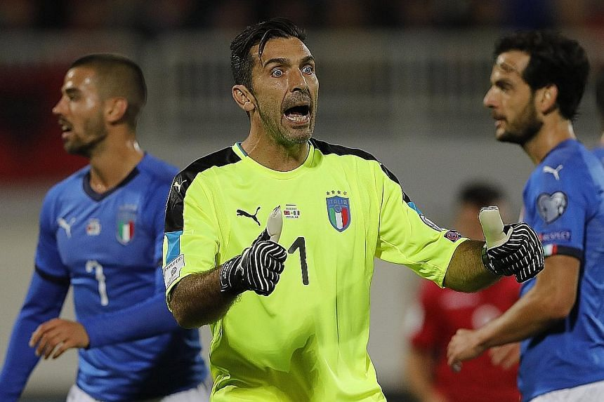 Gianluigi Buffon, the 39-year-old Italy captain, encouraging his team-mates during the World Cup qualifier against Albania in Shkoder. The Azzurri won 2-0 to finish behind Spain and will be reasonably confident of reaching the Finals.