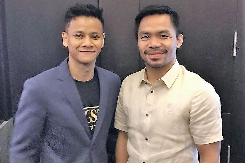 Ridhwan with Filipino boxing legend Manny Pacquaio at lunch yesterday. The get-together was organised by Singaporean billionaire and sports philanthropist Peter Lim.