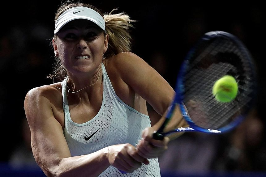 Maria Sharapova (above) of Russia in action against Magdalena Rybarikova of Slovakia in the Kremlin Cup first round in Moscow yesterday. Rybarikova had to grind her way to victory, likening the atmosphere to that for the Fed Cup.