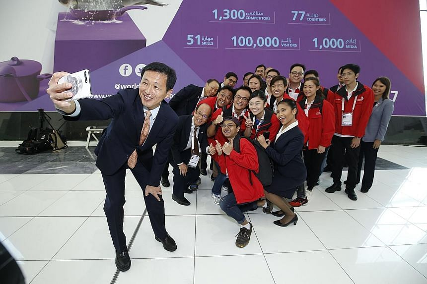 Education Minister (Higher Education and Skills) Ong Ye Kung with Singapore competitors and management staff from the polytechnics and Institute of Technical Education at the 44th international WorldSkills competition in Abu Dhabi, United Arab Emirat