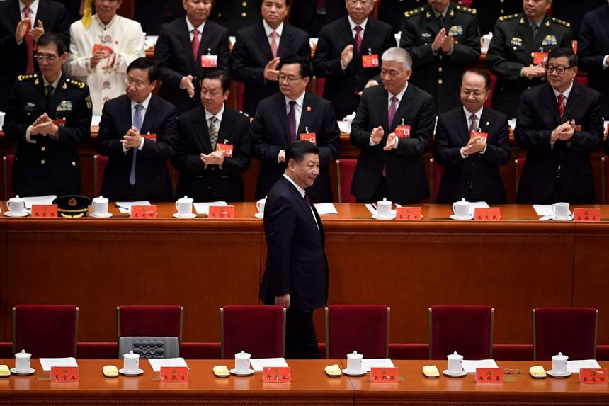Chinese President Xi Jinping (centre) attends the opening session of the 19th Communist Party Congress at the Great Hall of the People in Beijing, on Oct 18, 2017.