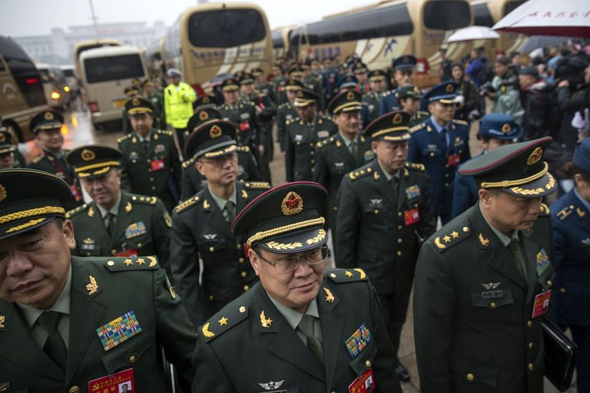 """Chinese military delegates arrive for the opening ceremony of the 19th National Congress. In President Xi Jinping's speech at the 19th Communist Party Congress on Wednesday, he also affirmed China's goal to """"develop a modern maritime military force s"""