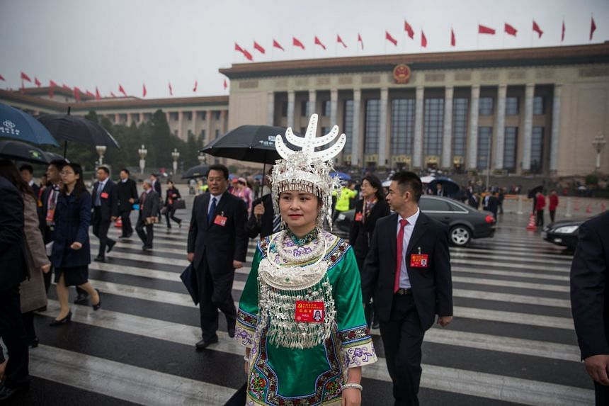 Delegates leaving after the opening ceremony of the 19th National Congress of the Communist Party of China (CPC).