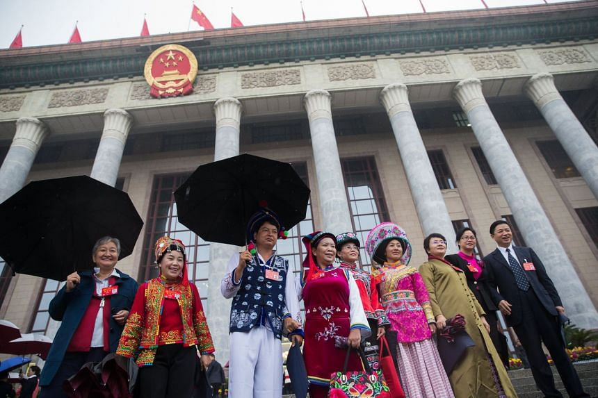 Chinese minority delegates wearing traditional costumes arriving for the opening ceremony of the 19th National Congress of the Communist Party of China (CPC).