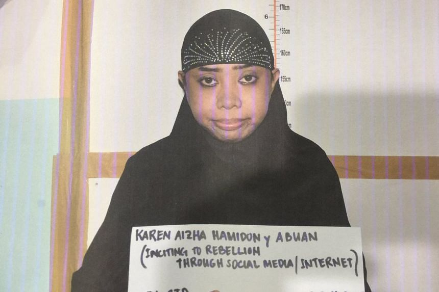 Karen Aizha Hamidon (above) is the ex-wife of Singaporean Muhammad Shamin Mohamed Sidek, a security guard detained in Singapore in August 2015 for planning to join ISIS and using social media to incite violence.