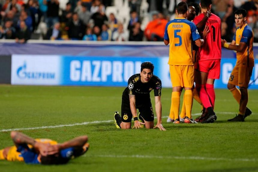 Dortmund's Spanish defender Marc Bartra (centre) reacts at the end of the UEFA Champions League football match between Apoel FC and Borussia Dortmund on Oct 17, 2017.