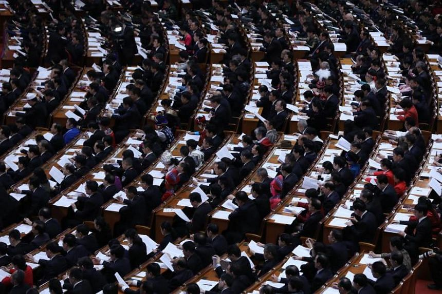 Delegates attend the opening ceremony of the 19th National Congress of the Communist Party of China in Beijing.