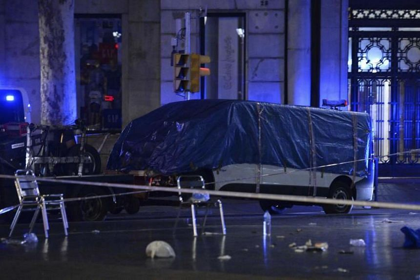 A file photo taken on Aug 18, 2017 shows the van that ploughed into the crowd at the Rambla in Barcelona. After a dozen such cases, authorities have struggled to protect public spaces without disrupting cities' open character or busting tight budgets