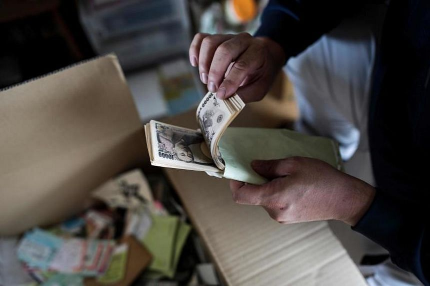 A growing number of Japanese are choosing to stash their cash in the humble home safe, wary of negative interest rates in the bank and out of the view of eagle-eyed tax officials.