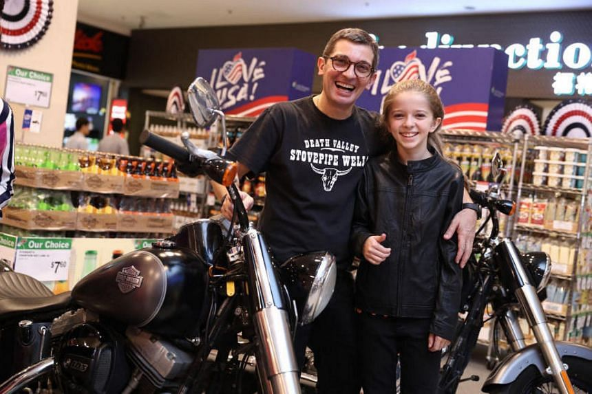 Mr Duarte Lopes de Mondoca and his daughter Leonor posing with the Harley-Davidson motorcycles displayed at the opening ceremony of the US Fair, on Oct 17, 2017.