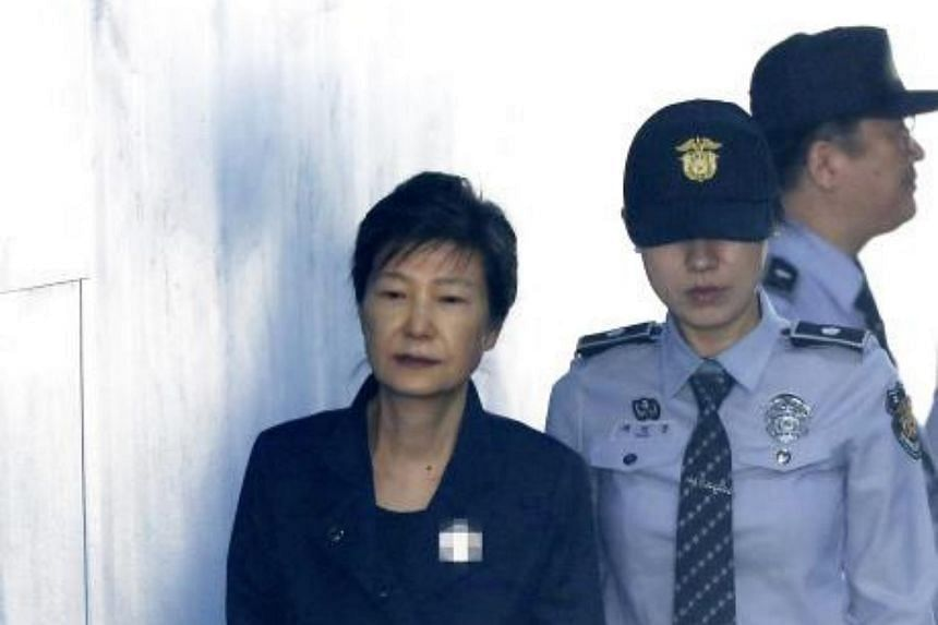 Ousted former President Park Geun-hye arrives to attend a hearing on the extension of her detention at a court in Seoul, South Korea on Oct 13, 2017.  She has been detained in a solitary cell at Seoul Detention Centre since she was arrested on March