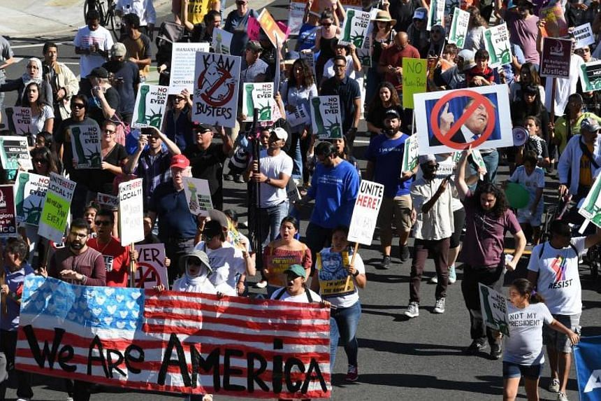 People participate in a march organized by the Council on American-Islamic Relations on Oct 15, 2017 in response to US President Donald Trump's most recent travel ban.