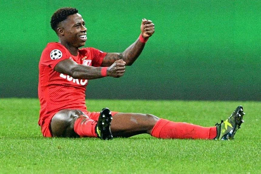 Spartak Moscow's Quincy Promes celebrates after scoring the team's fifth goal.