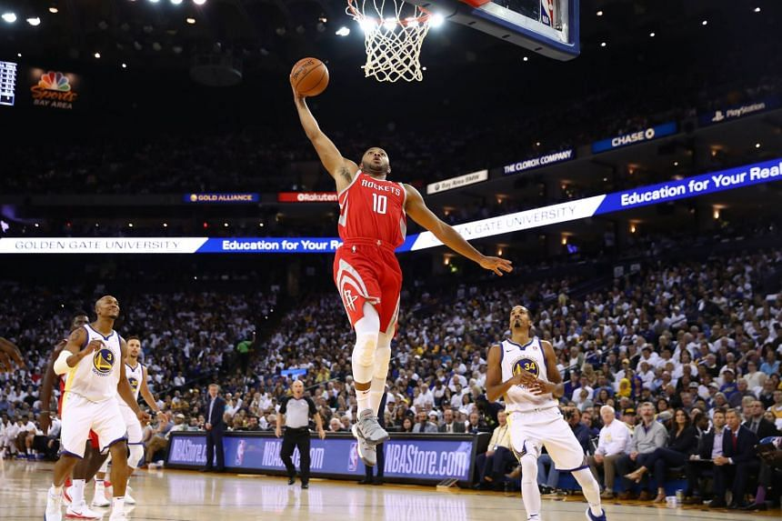 Eric Gordon of the Houston Rockets dunking the ball against the Golden State Warriors during their NBA game at Oracle Arena on Oct 17, 2017, in Oakland, California.