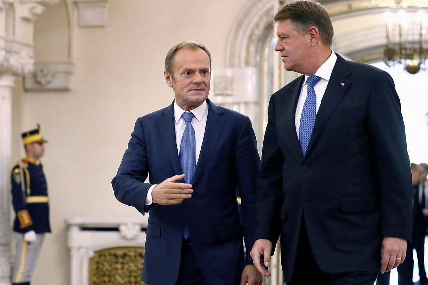 "European Council President Donald Tusk (left) meeting Romanian President Klaus Iohannis. Mr Tusk stressed that the talks could take place among the current 28 members, including Britain, or just the 27 remaining countries ""depending on the subject""."