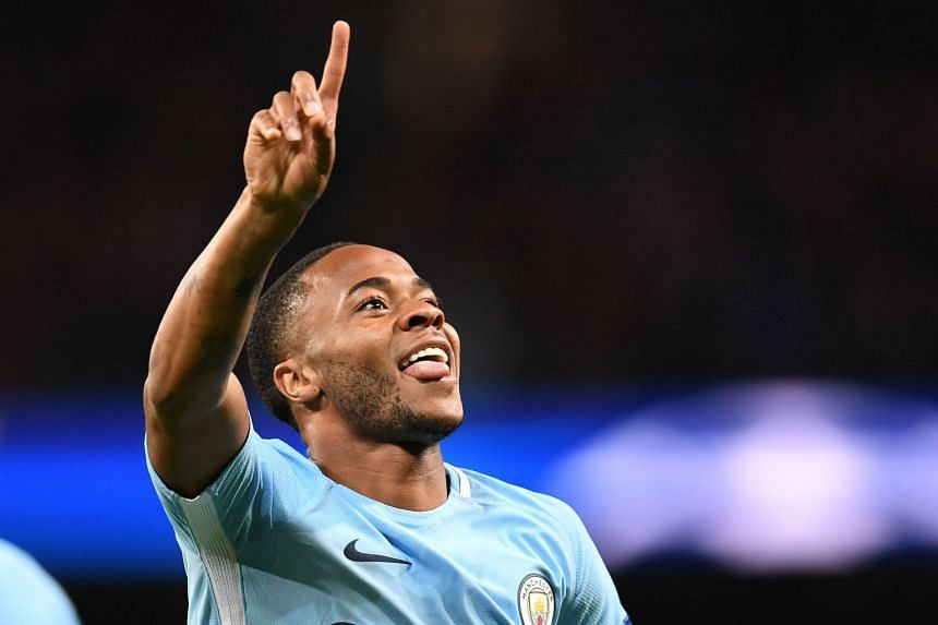 Manchester City's Raheem Sterling celebrates scoring the opening goal.