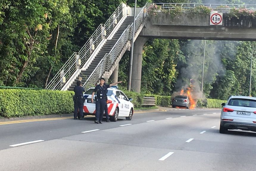 Police officers at the scene after a car caught fire along Lornie Road on Oct 18, 2017.