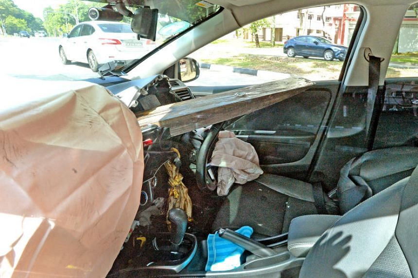 The impact drove one of the forklift's arms through the front of the car and into the driver's seat.