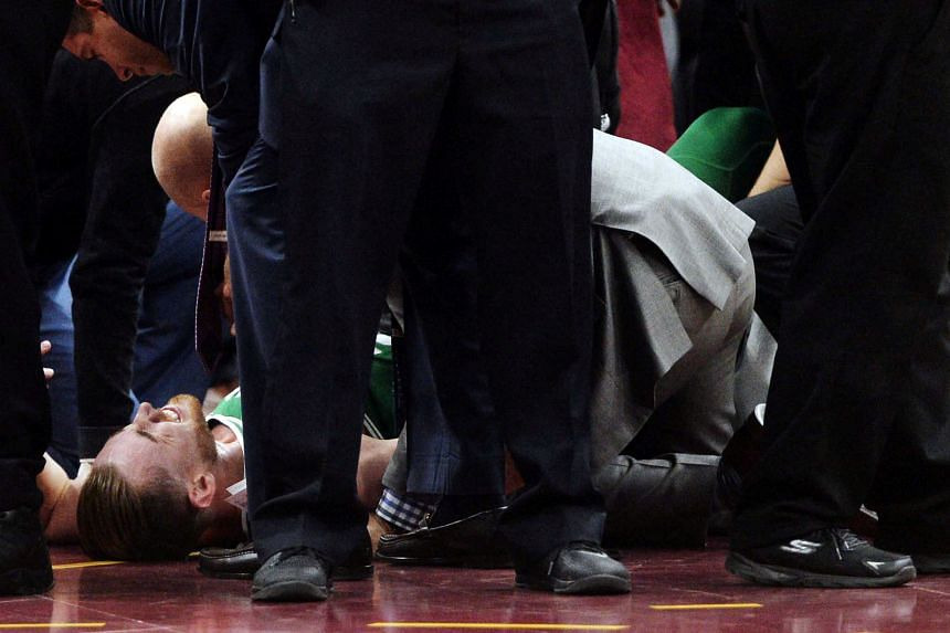 Boston Celtics forward Gordon Hayward lying on the court after injuring his ankle during the first half against the Cleveland Cavaliers at Quicken Loans Arena.