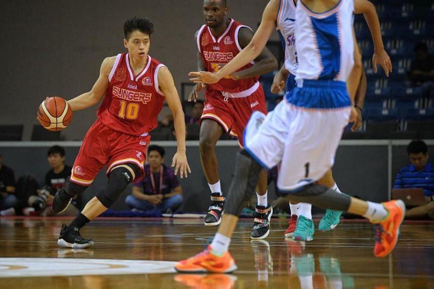 Leon Kwek (left) of the Singapore Slingers in action against the Shanghai Sharks during the Merlion Cup semi-final at the OCBC Arena on Sept 23, 2017.