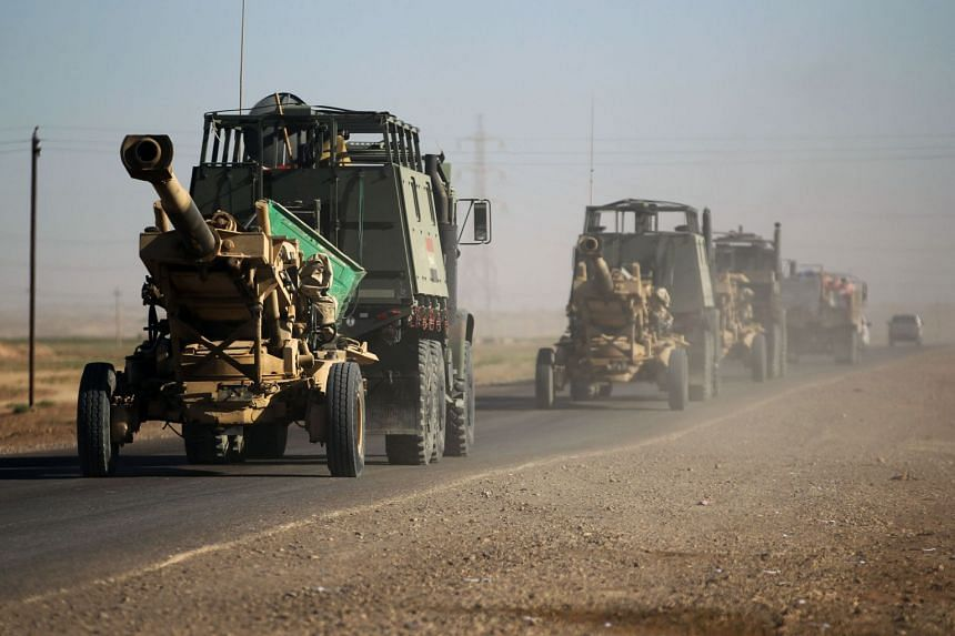 Iraqi army artillery are seen on a road south-west of Kirkuk, on Oct 17, 2017.