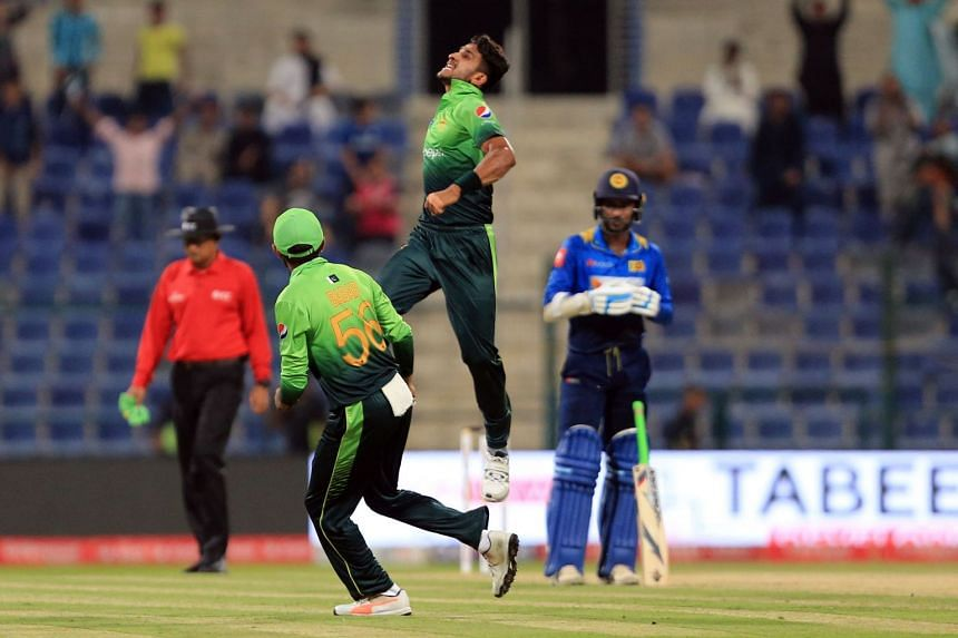 Pakistan's (centre) Hassan Ali celebrates after dismissing Sri Lanka's Kusal Mendis during the second one day international (ODI) cricket match between Sri Lanka and Pakistan at Sheikh Zayed Stadium in Abu Dhabi on Oct 16, 2017.
