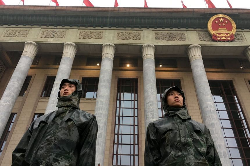 Soldiers standing guard outside the Great Hall of the People in Beijing before the opening of the 19th National Congress of the Chinese Communist Party.
