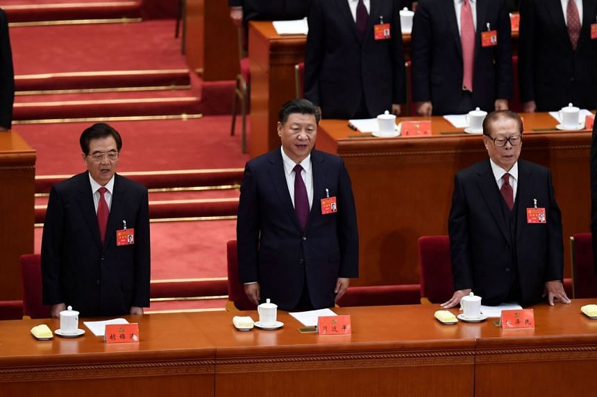Chinas President Xi Jinping (centre) sings the National Anthem with former presidents Jiang Zemin (right) and Hu Jintao (left) during the opening of the 19th Communist Party Congress at the Great Hall of the People in Beijing, on Oct 18, 2017.