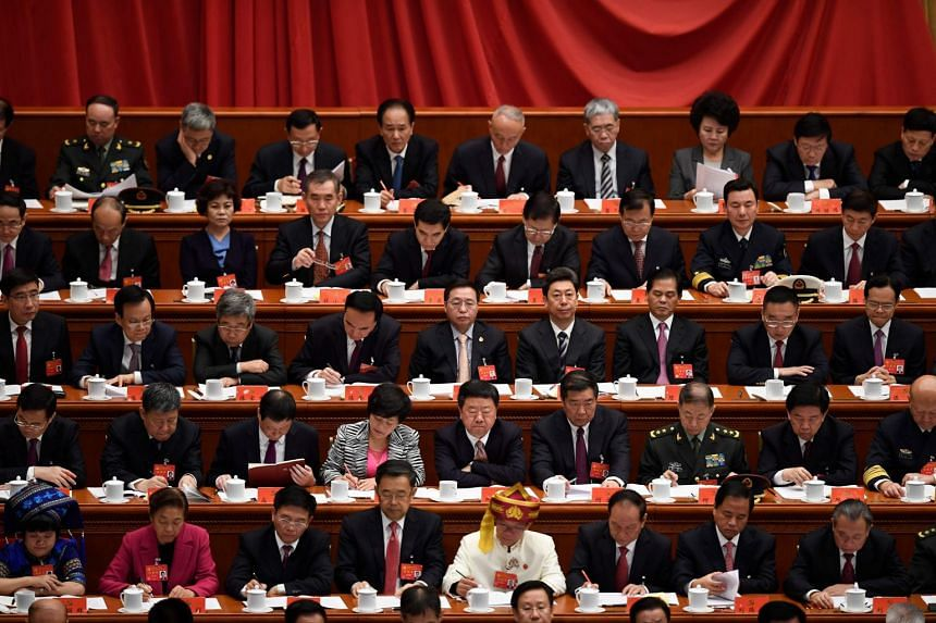 Delegates listen as Chinese President Xi Jinping delivers his address at the opening of the 19th Communist Party Congress at the Great Hall of the People in Beijing, on Oct 18, 2017.