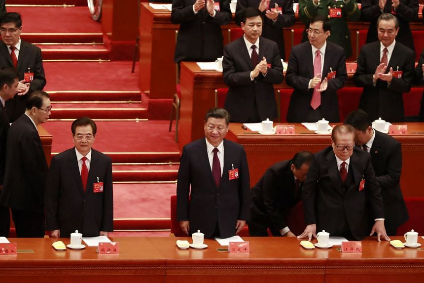 Chinese President Xi Jinping (centre), his predecessor Hu Jintao (right) and former President Jiang Zemin (second, right) arrive for the opening ceremony of the 19th National Congress of the Communist Party.