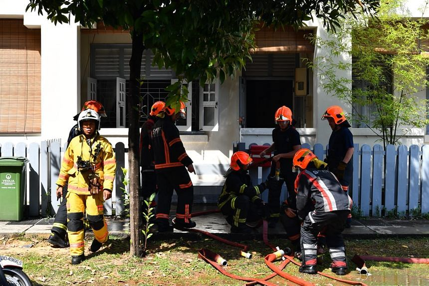 SCDF officers packing up after extinguishing the fire.