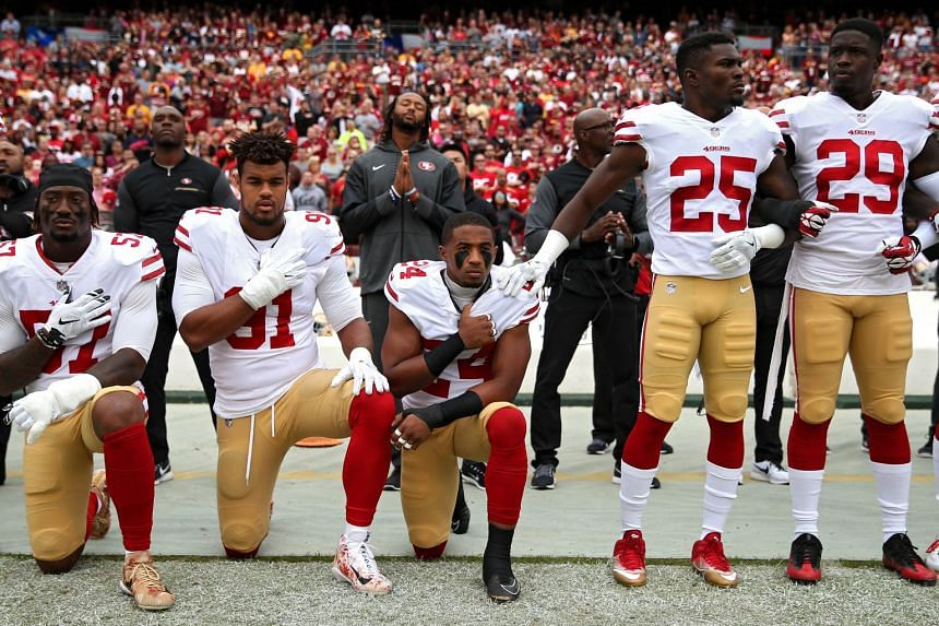 Arik Armstead and Eli Harold of the San Francisco 49ers kneel before a game during the national anthem on Oct 15, 2017.
