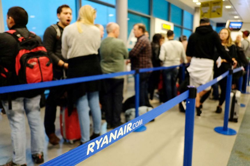 Passengers preparing to board a Ryanair flight at London Stansted Airport (left) in Britain. Malaysia Airlines CEO Peter Bellew (above), who left Ryanair in 2014, is returning to tackle its pilot shortage.