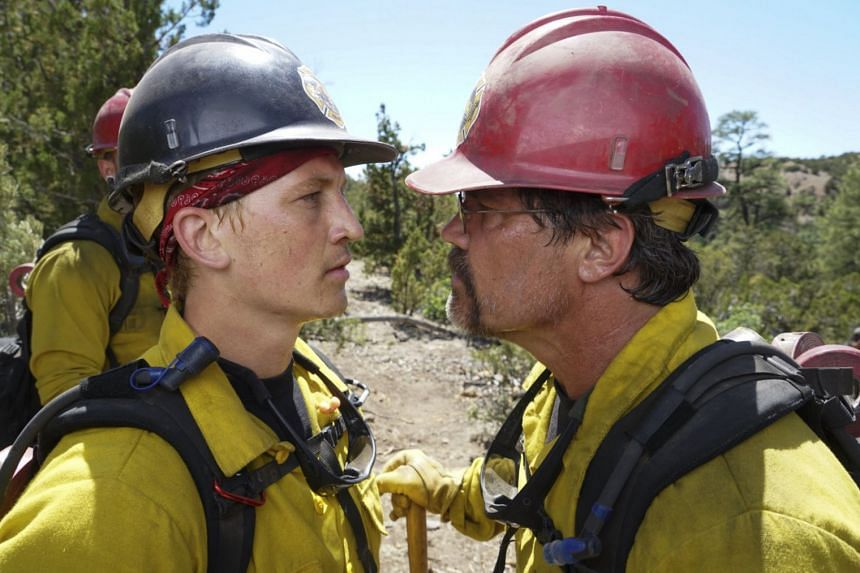 (From far left) Miles Teller and Josh Brolin portray real-life wildland firefighters of the Granite Mountain Hotshots, who found themselves facing a particularly devastating blaze in Arizona in 2013.