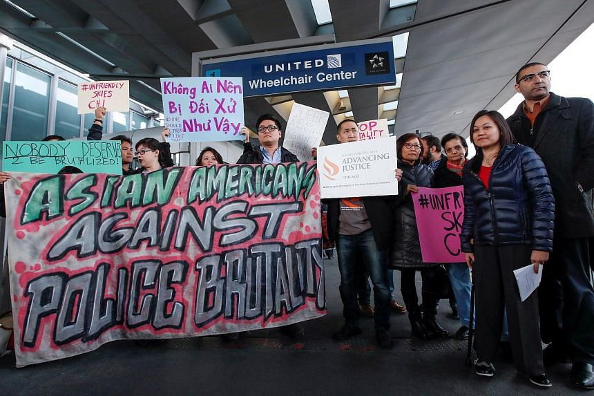 People protest a passenger being forcibly removed from a United Airlines flight at O'Hare International Airport in Chicago.