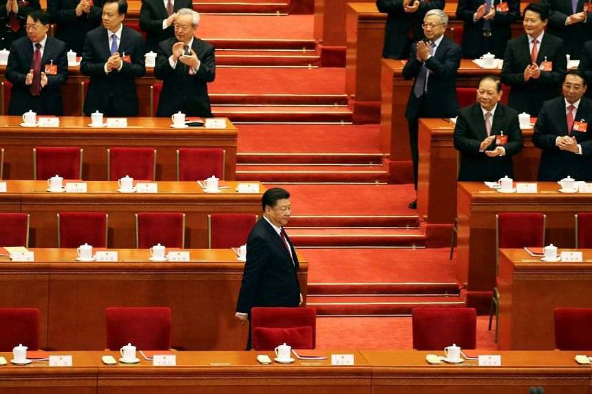 China's President Xi Jinping arrives for the closing session of China's National People's Congress (NPC) at the Great Hall of the People in Beijing on March 15, 2017.