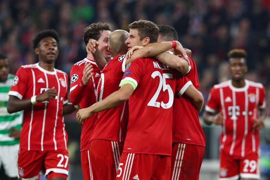 Bayern Munich's Thomas Muller celebrates scoring their first goal with Arjen Robben and team mates.
