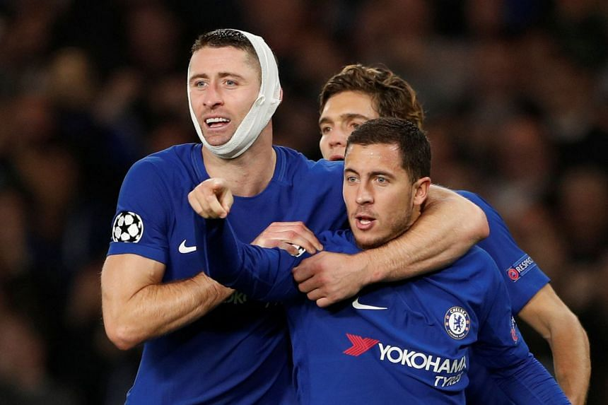 Chelsea's Eden Hazard celebrates scoring their third goal with Gary Cahill and Marcos Alonso.