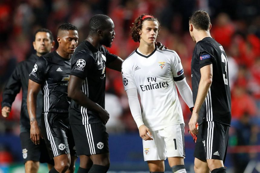 Benfica's Mile Svilar is consoled by Manchester United's Romelu Lukaku and Nemanja Matic after the match.