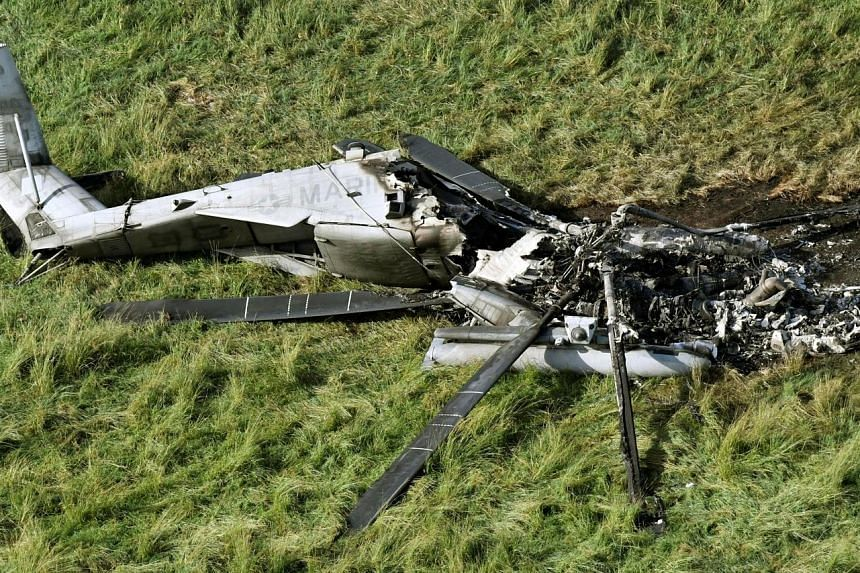 A wrecked US CH-53E transport helicopter in Okinawa last week. The US military said the blaze occurred after the aircraft had landed in the field and no crew were injured.