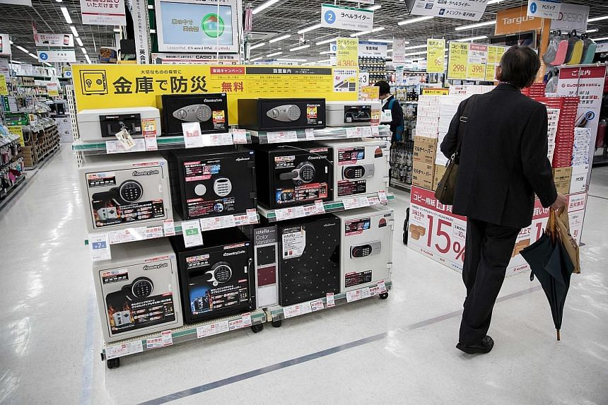 Sales of home safes are booming as Japanese look to stash cash at home, partly to avoid scrutiny by tax officials.