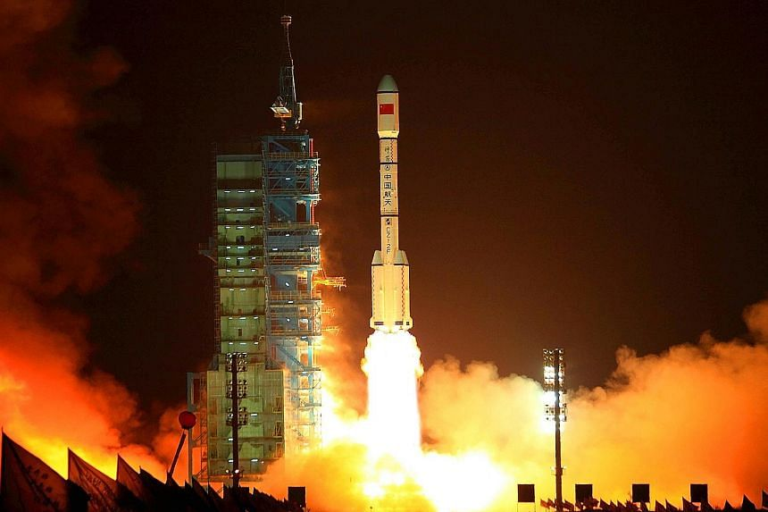 A rocket carrying the Tiangong-1 blasting off from the Jiuquan launch centre in Gansu province on Sept 29, 2011. In May, China told the UN that the lab would re-enter Earth between October and next April.