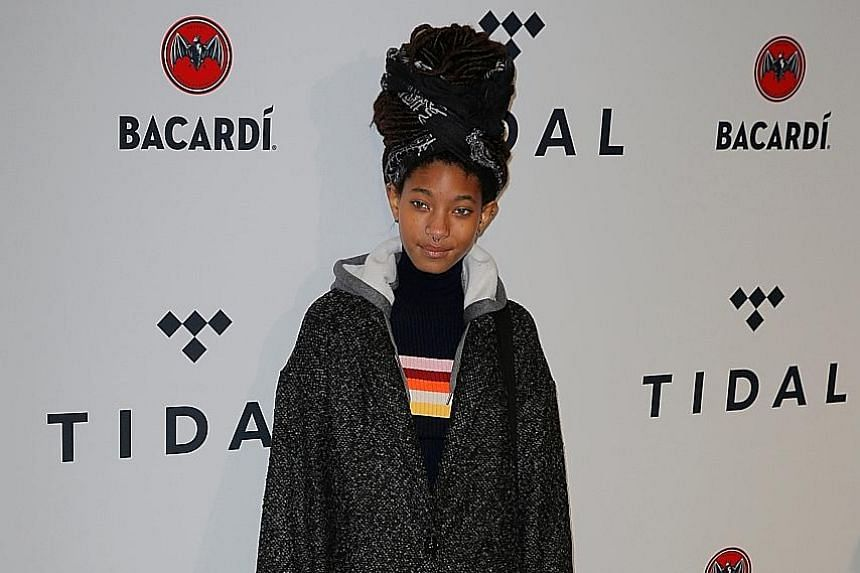 Singers such as Cardi B (above) and Willow Smith (left) arriving at music-streaming service Tidal's annual charity concert in New York on Tuesday. The service is owned by rapper Jay-Z, whose wife, pop superstar Beyonce, also attended the event, four