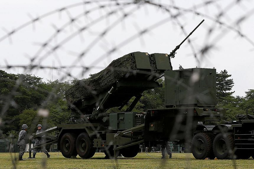 """Japanese soldiers holding a drill to mobilise their Patriot Advanced Capability-3 missile unit, in response to missile launches by North Korea, at Asaka base north of Tokyo. It's not just a matter of building the """"bomb"""" - Japan would have to build up"""